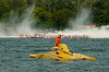 Jimmy Shane sitting on his disabled Grand Prix  hydroplane Long Gone (GP-7) watches as the Rolling Thunder (GP-88)  races by at the 2010 Syracuse Hydrofest  held at Onondaga Lake Park near Liverpool, New York on Saturday, June 19.