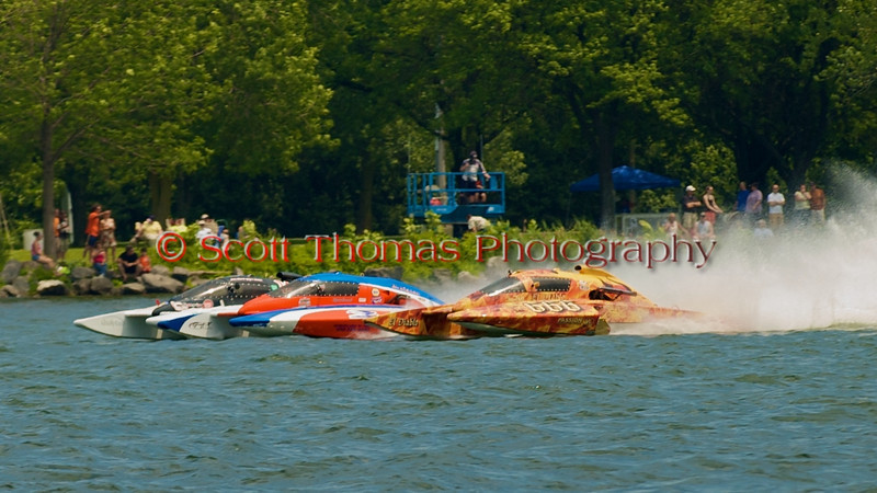 Hydroplanes E-149 (white), CE-2 (red) and CE-666 (yellow) head to the first turn after taking the green flag in a 5.0 Liter stock heat race at the 2010 Syracuse Hydrofest held at Onondaga Lake Park near Liverpool, New York on Saturday, June 19.