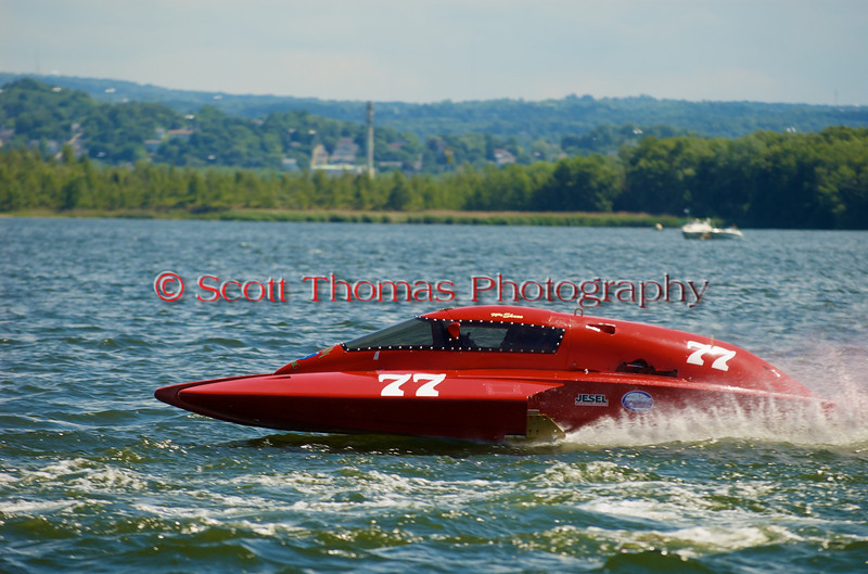 5.0 Liter Stock hydroplane Team Shane (CE-77) driven by Kelly Shane racing on the course at the 2010 Syracuse Hydrofest held at Onondaga Lake Park near Liverpool, New York on Sunday, June 20.