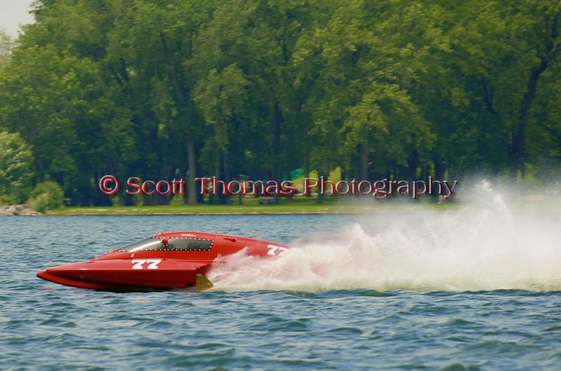 5.0 Liter Stock hydroplane nnnnnnnn (CE-77) driven by nnnnnnnnnnnn on the course at the 2010 Syracuse Hydrofest  held at Onondaga Lake Park near Liverpool, New York on Saturday, June 19.
