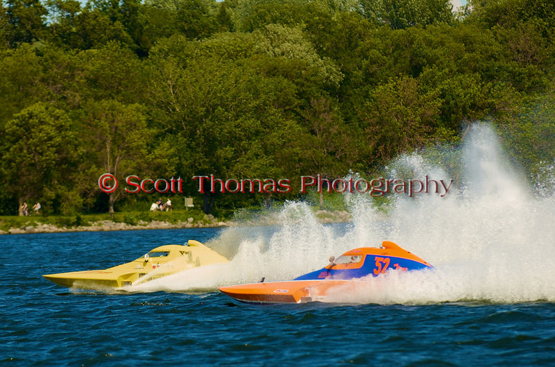 1.0 Liter Modified hydroplanes Fast Eddie Too (Y-1) and Roostertails (Y-52) race side by side at the 2010 Syracuse Hydrofest held at Onondaga Lake Park near Liverpool, New York on Sunday, June 20.