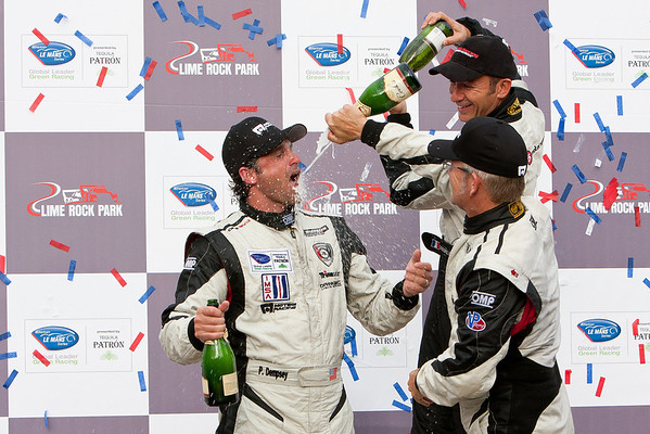 Patrick Dempsey get a taste of champagne from Joe Foster and Christophe Bouchut