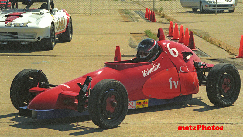 Waiting turn to run in the solo One practice at the national championships 1990.  Car was undated with taller rollbar in 1991.