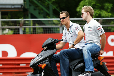 Michael Schumacher riding around the track before the 2011 Canadian Grand Prix - Thurs., June 9, 2011