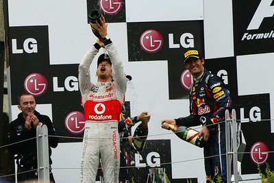 Jenson Button celebrates victory at the Canadian Grand Prix, Sunday, June 12, 2011