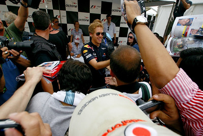 2010 F1 Champion Sebastial Vettel signs autographs for passionate Montreal fans, as Michael Schumacher signs fan cards in the background, Canadian Grand Prix, Thursday, June 9, 2011.