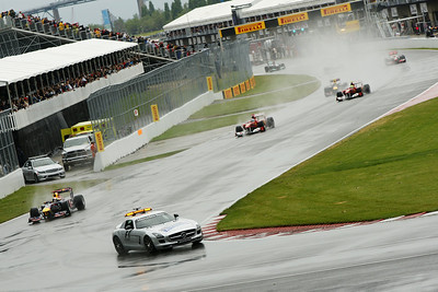 The Safety Car leads the first lap of the rain-soaked Canadian Grand Prix, Sunday, June 12, 2011