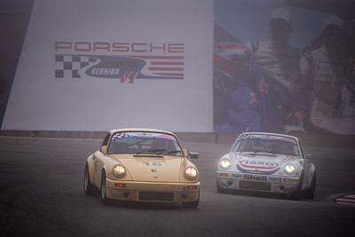 A 1981 911 SC Euro (left) and 1987 911 Carerra enter the famous Corkscrew in the fog.