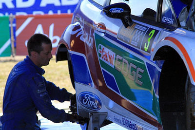 Ford Mechanic at Service working on Miko Hirvonens car.