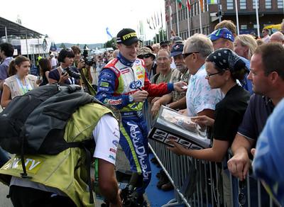 Jari-Matti Latvala signing autographs, Service Park (Day 2, Friday evening).
