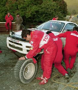 Carlos Sainz checks tyre wear.