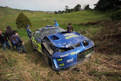 Xavier Pons, hit bank, rolled and slid backwards off road, SS8 Franklin.