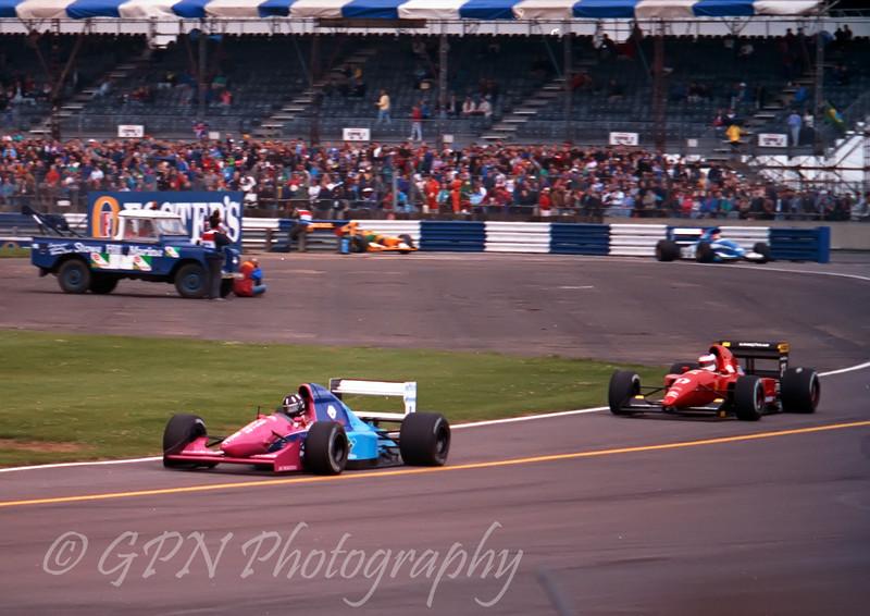 Damon Hill - Brabham Judd BT60B leads Jean Alesi - Ferrari FA92A out of the pits