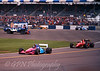 Damon Hill - Brabham Judd BT60B leads Jean Alesi - Ferrari FA92A out of the pits