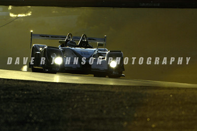 ALMS: The Butch Leitzinger Andy Wallace Dyson Racing Porsche RS Spyder approaching Corner 6 at sunset.  (Image #1DJ5118e)