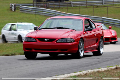 Red SN95 Mustang Coupe at Waterford Hills Raceway