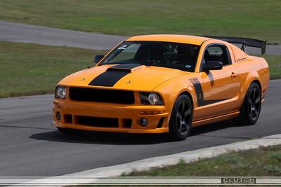 Orange Roush 427R TrakPak at Waterford Hills Raceway: top of turn 3