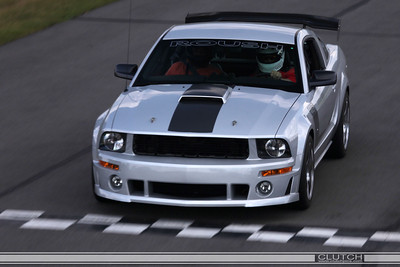 Silver Roush 427R at Waterford Hills Raceway: crossing finish line