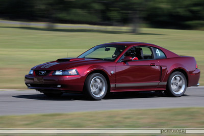 Red 2004 Ford Mustang at Waterford Hills Raceway: exiting Swamp turn