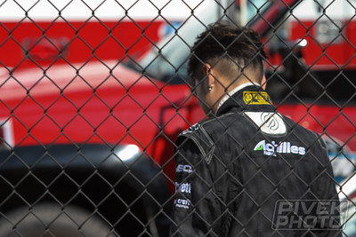 "Robbie ""Bushido"" Nishida (31) examines the damage on his Lexus SC300 after heavy contact with the Turn 1 wall at Evergreen Speedway.  He would be unable to continue."