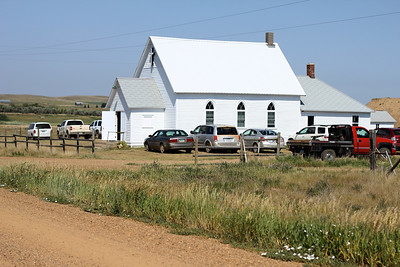 There was quite a crowd of vehicles around the church during the centennial.