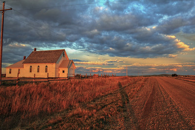 """I took this picture during the last of the """"good light"""" of the Mound Church. The sun was setting and there were a lot of clouds.  The color is actually pretty realistic. The light was very orange."""