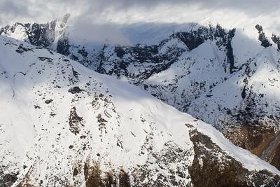 French Ridge and French Ridge Hut, winter, Gloomy Gorge and slopes of Rob Roy Peak beyond, Matukituki Valley, Mount Aspiring National Park