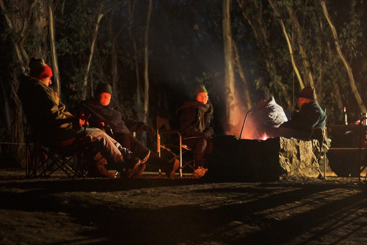 Sitting around the fire.