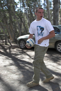 Simon plays a bit of footy: of one variety or another.