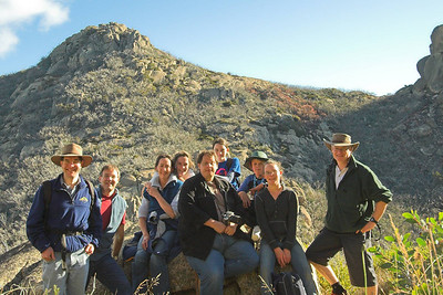 The group takes a moment to rest on a rock after our walk around Track 14 (Corral - Castle Track). The Hump (left) and the Cathedral (right) are behind us. Jon Buttery, Anthony Holmes, Maureen Harrick, Emma Harrick, Dennis Adami, Bethany Harrick, James, Grace Harrick, Mark Harrick.