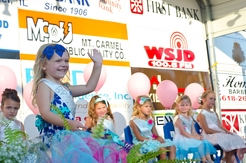 Brooklyn Bertram waves as she walks up to answer her question for the Little Miss Ag Days pageant on Wednesday, Aug. 10, 2016.