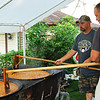 """Jason Brown and Rodney Burgger stir the Knights of Columbus chowder at the annual event on Sunday at 9 a.m.  The pair were working """"second shift"""" and had been stirring since 6 a.m."""