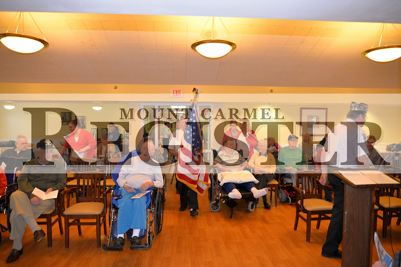 Gary Arnold leads the color guard into the main room at Oakview Heights Tuesday morning, Nov. 11, in Mt. Carmel.