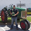 Marcus Smith/The Register<br /> Bryce Pavia's poses with his 1950 model Oliver 77. He took the peoples' choice award from the Tractor Show  Saturday at the 2015 AG Days.