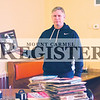 T.J. Hug/The Register<br /> Rick Marshall, owner of Hogg Heaven, holds a picture of Don Liddle, a Mount Carmel-born major league star of yesteryear, as he continues to adjorn his walls with pieces of Wabash County history.  In front of him are several records which will dress one of the walls of the BBQ restaurant.