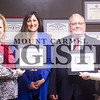 Marcus Smith/The Register<br /> <br /> Abbey Brian and Stephen Sawyer are presented with their first dollar fom Lesley Hipsher, executive director, and Brittany Campagna, president, of the Wabash County Chamber of Commerce Feb. 12 at the law offices of Stephen G. Sawyer and Farrar & Brian.