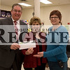 Marcus Smith/The Register<br /> <br /> Tim Buss, District 348 superintendent, accepts a $2,000 donation from Patti Knox, store manager, and Tanya Adams, assistant store manager, Feb. 5 at Shopko. The money was donated through Shopko's Help Us Give Back initiative during December. The Shopko Donation donated $1 for every customer signature, up to $2,000, between Dec. 1 - Dec. 24.