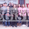 Marcus Smith/The Register<br /> <br /> Erika Kieffer, owner, cuts the ribbon Feb. 25 at her Eclectic Boutique. The store sales women's clothing and accessories, as well as some home decor items.