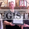 Marcus Smith/The Register<br /> <br /> Rick Marshall (Center), owner of Hogg Heaven, accepts a milestone dollar from Lesley Hipsher (right), executive director of the Wabash County Chamber, and Brittany Campgna, president of the Wabash County Chamber.