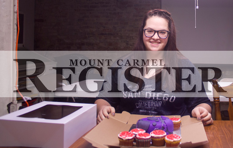 Marcus Smith/The Register<br /> <br /> Abygail Hicks shows off some of her baked goods she is selling for her Creating Entreprenurial Opportunities (CEO) class project Feb. 17.