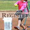 Marcus Smith/The Register<br /> <br /> Hailey Lang, 11 practices pitching for the travel league March 5 at a baseball feld at Railreoad and Mulberry Streets.