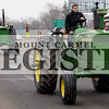 Marcus Smith/The Register<br /> <br /> Deric Wright, Brad Hocking, Brett Alka and Bill Alka were four of five people on tractors leading the funeral procession of Tom Hoffman March 9 down 9th Street.