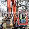 Marcus Smith/The Register<br /> <br /> Mark Vaughn, equipment operator for Kieffer Brothers, uses a back hoe to fill in an excavation March 7 on College Drive in front of Wabash Valley College. This marks the end point for the College Drive project, now crews will have to form and pour curbs and the side walk.
