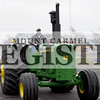 Marcus Smith/The Register<br /> <br /> Bill Alka drives a tractor down 9th Street leading the funeral procession of Tom Hoffman March 9. Hoffman spent his life farming, was a member of the Wabash County Youth Exhibition Board for more than 40 years and was the first one at  the fair and last one to leave County Fair Week.