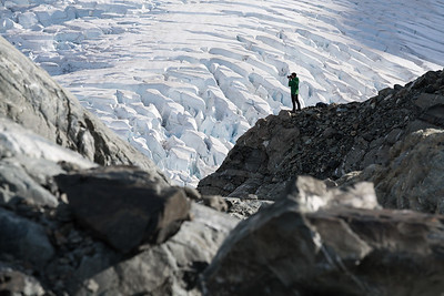 A photographer stands above the Hochstetter Icefall, Grand Plateau