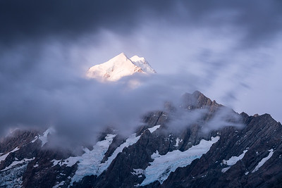 Cloud reveals views of South Faces of Aoraki Mount Cook and Nazomi