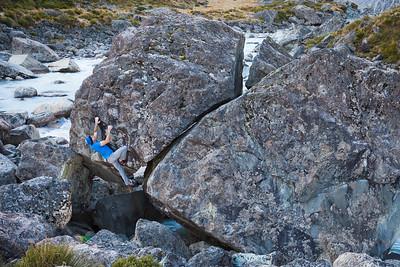 Boulderer on first ascent of Hop Zombie (V5/6), Hooker Valley, Aoraki Mount Cook National Park.