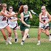 GEOFF SMITH — THE BERKSHIRE EAGLE<br /> Mount Greylock's Caroline Flynn, right, stick checks Oakmont's Jackie Beaty as Emma Polumbo helps out during a Central/Western Massachusetts Division II quarterfinal Thursday. The Mounties won 11-10.