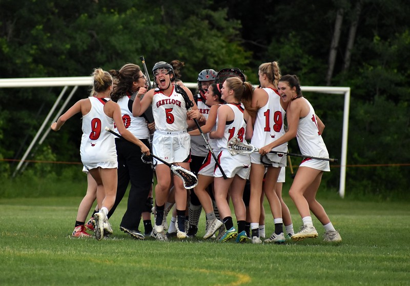 GEOFF SMITH — THE BERKSHIRE EAGLE<br /> THe Mount Greylock girls lacrosse team celebrates its 11-10 win over Oakmont in the Central/Western Massachusetts Division II quarterfinals Thursday.