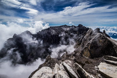 Clouds rolling into Low's Gully, as seen from the summit of Mount Kinabalu, Borneo (4,095m)